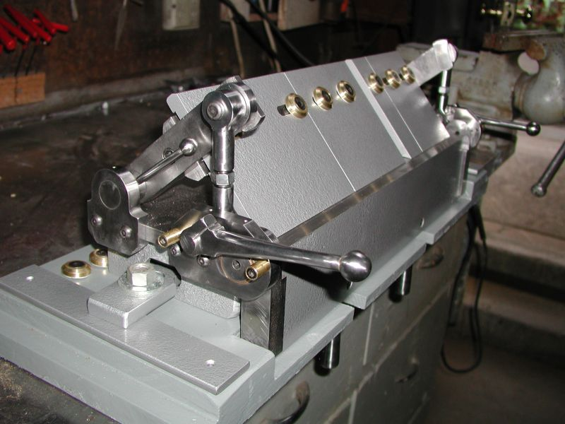 The traditional solution for bending sheet metal in shops has been a box and pan brake or finger brake. There are plans readily available to make nice ones ...