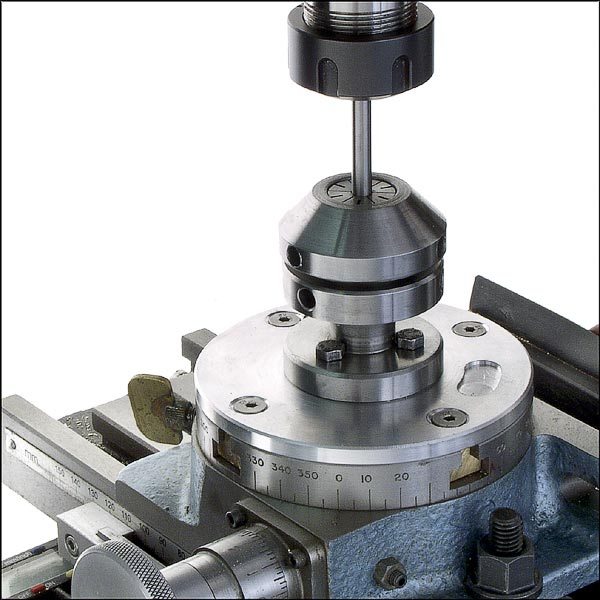 Use a collet fixture on the rotab to center under the spindle