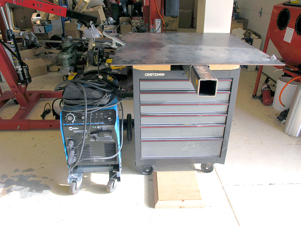 Welding table on rolling tool cabinet